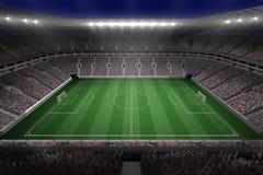 Μεγάλο γήπεδο ποδοσφαίρου με τα φω'τα απεικόνιση αποθεμάτων