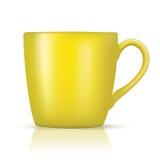 Μεγάλο κίτρινο φλυτζάνι Στοκ Εικόνες