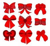 Μεγάλο σύνολο κόκκινων τόξων δώρων με τις κορδέλλες Στοκ εικόνα με δικαίωμα ελεύθερης χρήσης
