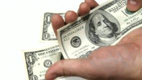 Μειωμένα δολάρια στο άσπρο υπόβαθρο απόθεμα βίντεο
