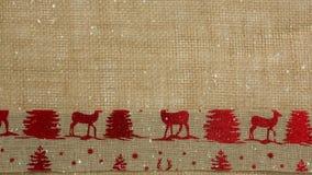 Μειωμένο χιόνι με το κλωστοϋφαντουργικό προϊόν ταράνδων Χριστουγέννων φιλμ μικρού μήκους