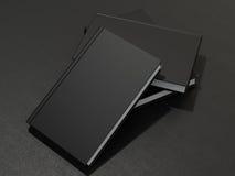 Μερικά βιβλία με τη μαύρη κενή κάλυψη Στοκ Φωτογραφίες