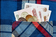 Μερικά ρωσικά ryubles στην ελεγμένη τσέπη πουκάμισων Στοκ Φωτογραφίες