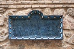 Μεσαιωνική ένωση πινακίδων στον τοίχο πετρών Στοκ Εικόνες