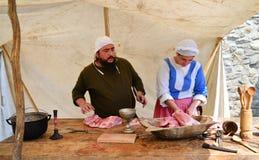 Μεσαιωνικοί μαγειρεύοντας άνθρωποι Στοκ Εικόνες