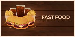 Μεσημεριανό γεύμα με τις τηγανιτές πατάτες, burger και τη σόδα take-$l*away στο απομονωμένο υπόβαθρο Ξύλινη σύσταση Γρήγορο φαγητ Στοκ Εικόνες