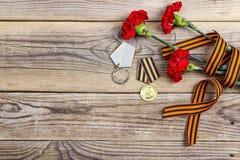 Μετάλλια του μεγάλου πατριωτικού πολέμου, της κορδέλλας του ST George ` s και του κόκκινου carna στοκ εικόνες με δικαίωμα ελεύθερης χρήσης