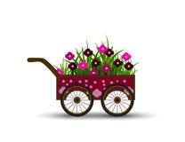 Μεταφορά με τα λουλούδια και χλόη που απομονώνεται στο άσπρο υπόβαθρο Στοκ φωτογραφία με δικαίωμα ελεύθερης χρήσης