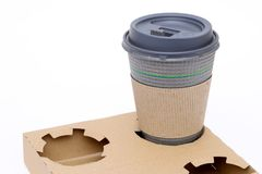 Μεταφορέας πολτού και φλυτζάνι καφέ στοκ εικόνες
