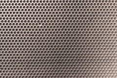 Μεταλλικό κυψελωτό hexagon ψημένο στη σχάρα σχέδιο μπροστά από το SPE μουσικής στοκ εικόνες με δικαίωμα ελεύθερης χρήσης