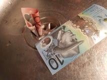 Μετρητά που σπαταλιούνται Στοκ εικόνα με δικαίωμα ελεύθερης χρήσης