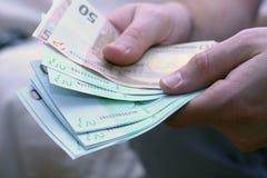 μετρώντας ευρώ Στοκ Εικόνα