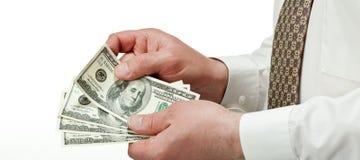 μετρώντας χέρια s δολαρίων επιχειρηματιών τραπεζογραμματίων Στοκ Φωτογραφία