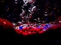 Μελάνι χρώματος που στροβιλίζεται στο πετρέλαιο Στοκ φωτογραφία με δικαίωμα ελεύθερης χρήσης