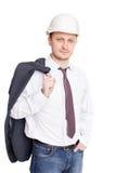με βεβαιότητα σκληρό καπέλο μηχανικών που στέκεται άσπρο Στοκ φωτογραφίες με δικαίωμα ελεύθερης χρήσης