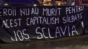Μηνύματα στο μαύρο baner στη Ρουμανία Στοκ Εικόνες