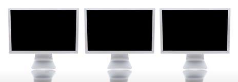 μηνύτορες τρία υπολογισ& Στοκ Εικόνες