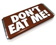 Μην με φάτε ανθυγειινό άχρηστο φαγητό φραγμών καραμελών σοκολάτας λέξεων Στοκ φωτογραφία με δικαίωμα ελεύθερης χρήσης