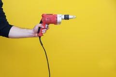 Μηχανή διατρήσεων χειρισμού ατόμων Στοκ Εικόνα