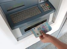 μηχανή του ATM και ευρωπαϊκά τραπεζογραμμάτια χρημάτων στοκ εικόνες