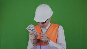 Μηχανικός ή οικοδόμος με τα χρήματα που συλλαμβάνεται για τη δωροδοκία Προϊστάμενος στις χειροπέδες chromakey Ο διεφθαρμένος προϊ φιλμ μικρού μήκους