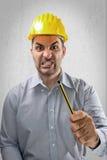 0 μηχανικός με ένα κράνος στο κεφάλι του Στοκ Εικόνες