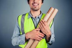 Μηχανικός με την οικοδόμηση των σχεδίων Στοκ Φωτογραφίες