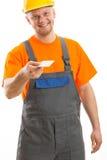 Μηχανικός που δίνει την κενή επαγγελματική κάρτα Στοκ Φωτογραφία