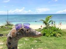 Μια άσπρη παραλία άμμου στοκ φωτογραφίες με δικαίωμα ελεύθερης χρήσης