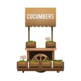 Μια αγορά οδών Ξύλινο κάρρο για τα αγγούρια πώλησης Πωλώντας λαχανικό Στοκ εικόνες με δικαίωμα ελεύθερης χρήσης