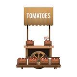Μια αγορά οδών Ξύλινο κάρρο για τις ντομάτες πώλησης πωλώντας λαχανικά Στοκ Εικόνες