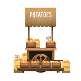 Μια αγορά οδών Ξύλινο κάρρο για τις πατάτες πώλησης Πώληση των λαχανικών Στοκ Εικόνα
