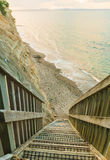 Μια απότομη κάθοδος στη θάλασσα, χερσόνησος Whangaparaoa, Aockland, Νέα Ζηλανδία στοκ φωτογραφία