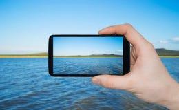 Μια εκμετάλλευση χεριών ατόμων έξυπνη στοκ φωτογραφίες με δικαίωμα ελεύθερης χρήσης
