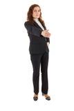 Μια επιχειρησιακή γυναίκα που στέκεται μπροστά από τη κάμερα Στοκ εικόνα με δικαίωμα ελεύθερης χρήσης