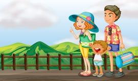 Μια ευτυχής οικογένεια στην ξύλινη γέφυρα απεικόνιση αποθεμάτων