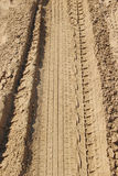 Μια διαδρομή ροδών στην άμμο Στοκ Εικόνες