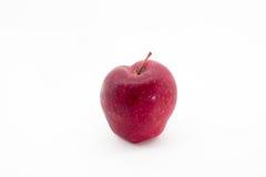 Μια κινηματογράφηση σε πρώτο πλάνο της Apple με το άσπρο υπόβαθρο Στοκ εικόνα με δικαίωμα ελεύθερης χρήσης