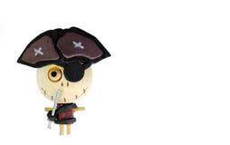 Μια κούκλα πειρατών του ξύλου σε ένα άσπρο υπόβαθρο Στοκ Εικόνες