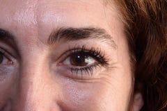 Μια λεπτομέρεια των ρυτίδων το στα μάτια γυναικών ` s στοκ φωτογραφία με δικαίωμα ελεύθερης χρήσης