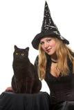 Μια μάγισσα με μια μαύρη γάτα Στοκ Φωτογραφίες