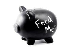 Μια piggy τράπεζα με την τροφή λέξεων Στοκ Φωτογραφία