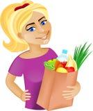 Μια νέα ευτυχής γυναίκα με τα τρόφιμα Στοκ Εικόνα