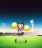 Μια νέα γυναίκα που χορεύει στο γήπεδο ποδοσφαίρου Στοκ Φωτογραφία