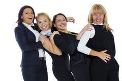 Μια ομάδα τεσσάρων επιχειρησιακών γυναικών σε ένα άσπρο υπόβαθρο Επιχείρηση wo στοκ εικόνες