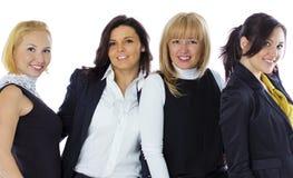 Μια ομάδα τεσσάρων επιχειρησιακών γυναικών σε ένα άσπρο υπόβαθρο Επιχείρηση wo στοκ εικόνες με δικαίωμα ελεύθερης χρήσης