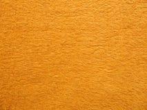Μια πλήρης σελίδα της πορτοκαλιάς γούνας faux, χνουδωτό υλικό Άποψη της κορυφής στην κινηματογράφηση σε πρώτο πλάνο σύστασης υποβ Στοκ Φωτογραφίες