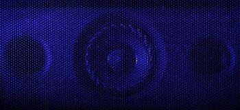Μια στενή επάνω μακρο φωτογραφία ενός ακουστικού ομιλητή που χρησιμοποιεί ένα μπλε πήκτωμα λάμψης στοκ εικόνα με δικαίωμα ελεύθερης χρήσης