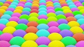 Μια τεράστια δονούμενη σειρά ζωηρόχρωμων σφαιρών γκολφ Στοκ Εικόνα