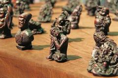 Μικρά ειδώλια του Βούδα, Ganesha, βάτραχος στην αγορά των bazaars στην Ινδία Δώρο Ινδία αναμνηστικών στοκ εικόνες